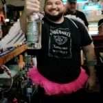 white-buffalo-saloon-man-wearing-jack-daniels-shirt-and-pink-tutu-holding-bottle-of-liquor